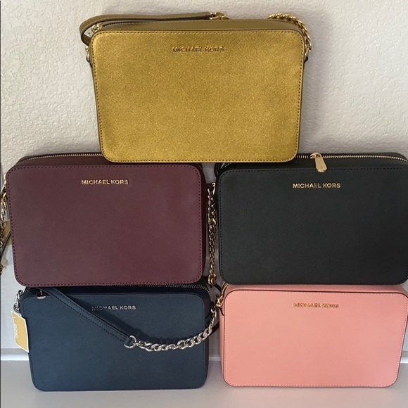 Michael Kors Handbags - NWT Jet Set Travel Michesl Kors crossbody